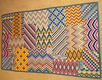 McIntyre rug: needlepoint design stitched by Loveday Spencer of Hexham